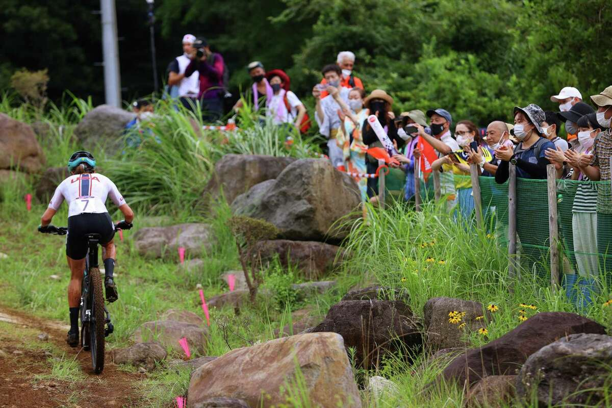 IZU, JAPAN - JULY 27: Kate Courtney of Team United States rides while fans watch during the Women's Cross-country race on day four of the Tokyo 2020 Olympic Games at Izu Mountain Bike Course on July 27, 2021 in Izu, Shizuoka, Japan. (Photo by Tim de Waele/Getty Images)