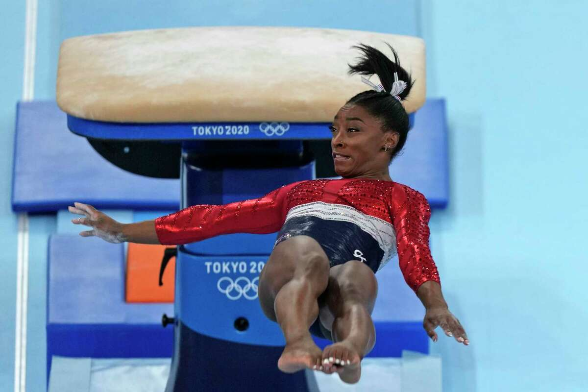 Simone Biles, of the United States, performs on the vault during the artistic gymnastics women's final at the 2020 Summer Olympics, Tuesday, July 27, 2021, in Tokyo.