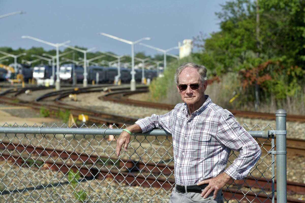 Mayor Bill Curtis stands near New Jersey Transit trains and tracks in Bay Head, N.J., on July 17, 2021.