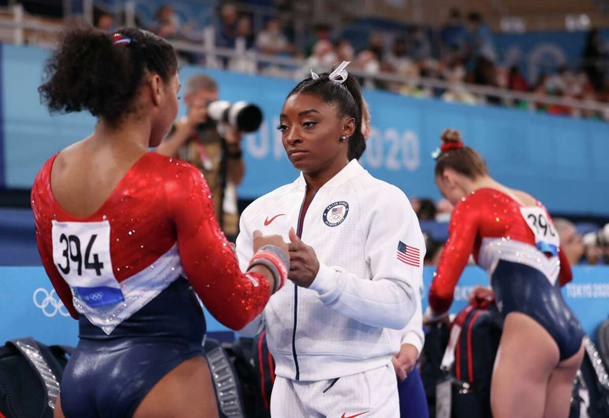 Simone Biles talks with Jordan Chiles of Team United States during the Women's Team Final on day four of the Tokyo 2020 Olympic Games at Ariake Gymnastics Centre on July 27, 2021 in Tokyo, Japan. (Laurence Griffiths/Getty Images/TNS)