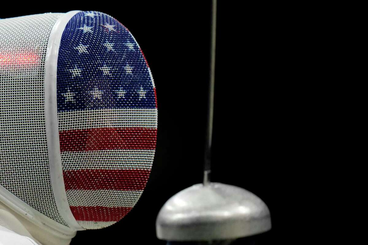 Kelley Hurley of the United States competes against Chu Ka Mong of Hong Kong in the women's individual epee team classification 5-8 competition at the 2020 Summer Olympics, Tuesday, July 27, 2021, in Chiba, Japan.