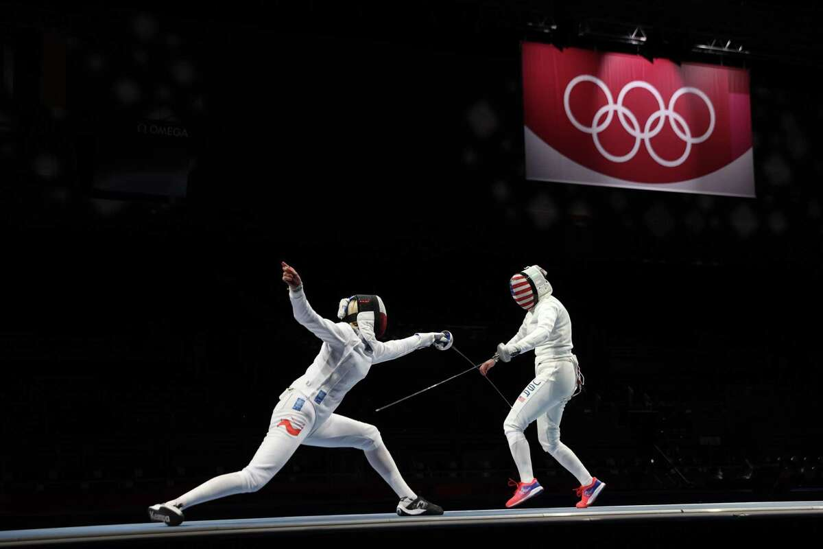Magdalena Piekarska-Twardochel of Team Poland, left, competes against Kelley Hurley of Team United States in Women's epee team placement 5-6 on day four of the Tokyo 2020 Olympic Games at Makuhari Messe Hall on July 27, 2021 in Tokyo.