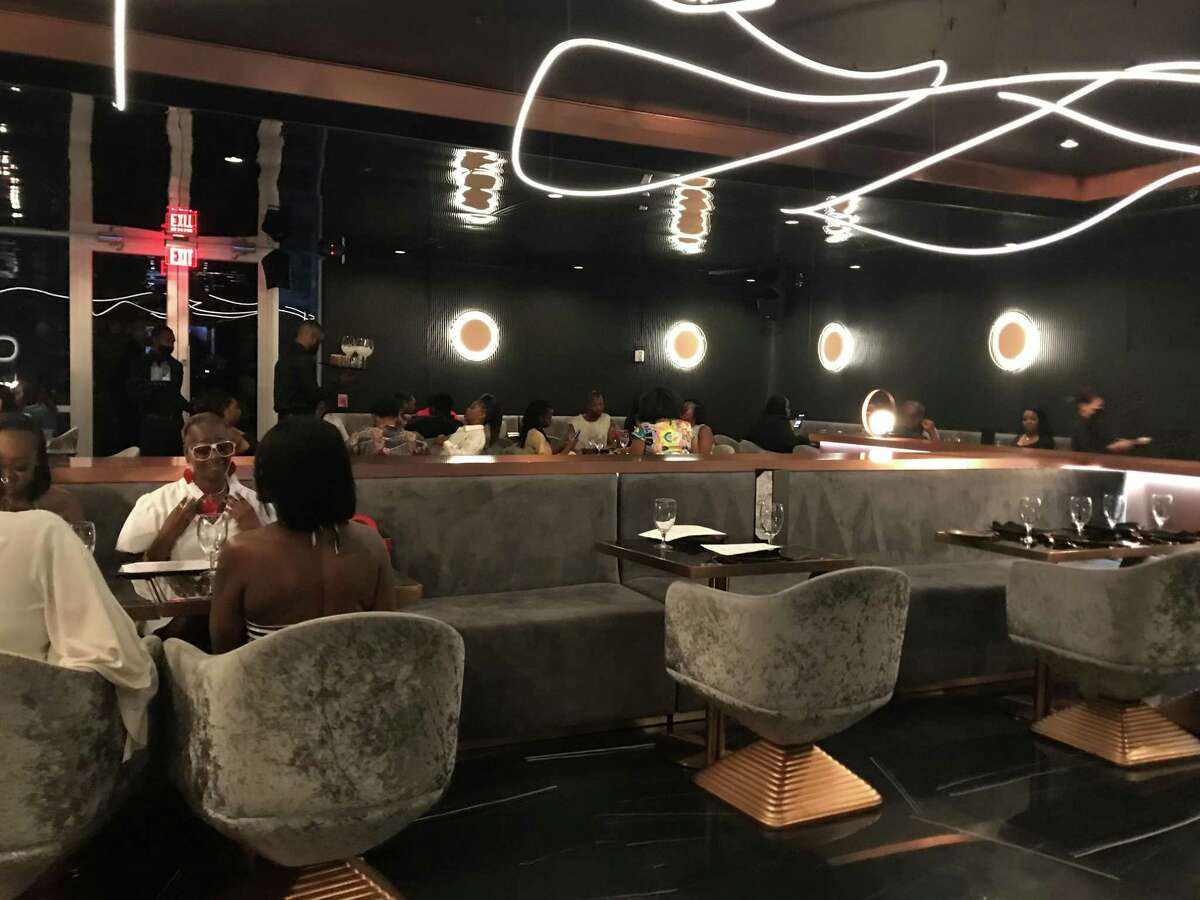 Lavish touches incorporating seafood and neo-soul are the hallmarks of the swanky Thirteen in Midtown.