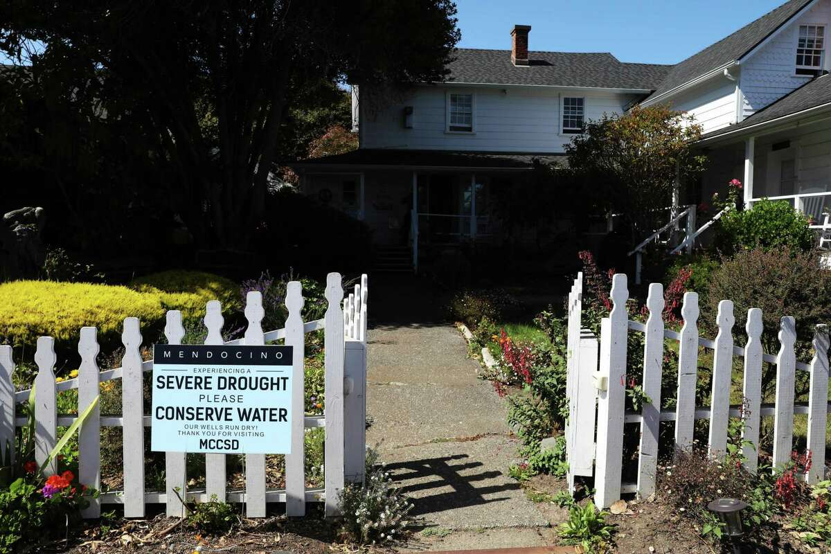 A sign posted outside of the Seagull Inn Bed & Breakfast in Mendocino urges people to conserve water. Mendocino is running low on water because its wells are running dry.