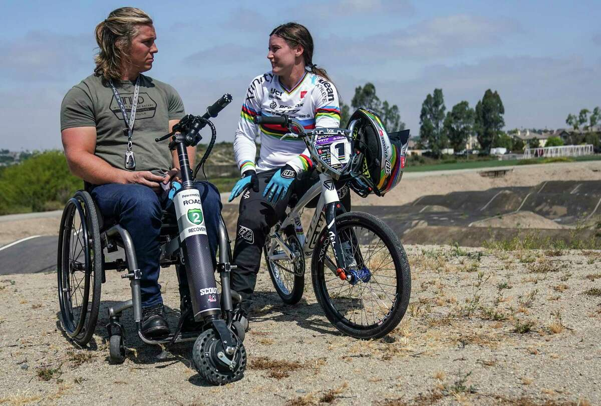 Sam Willoughby, left, talks with his wife, Olympic BMX racer Alise Willoughby while training in Chula Vista, Calif.