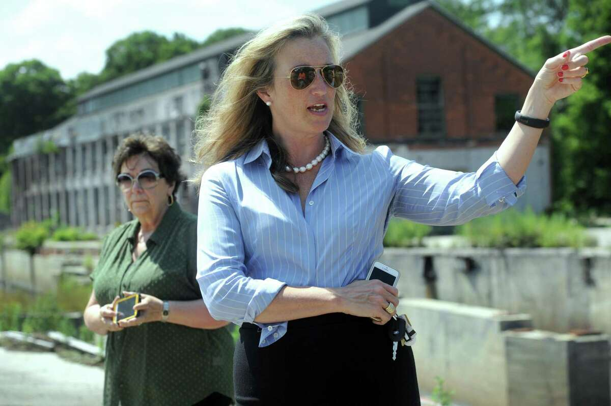 Julia Pemberton, first selectman of Redding, Conn., with Patricia Moisio, left, town tax collector, talks about the former Gilbert and Bennet wire mill in Redding, Thursday, August 7, 2014.