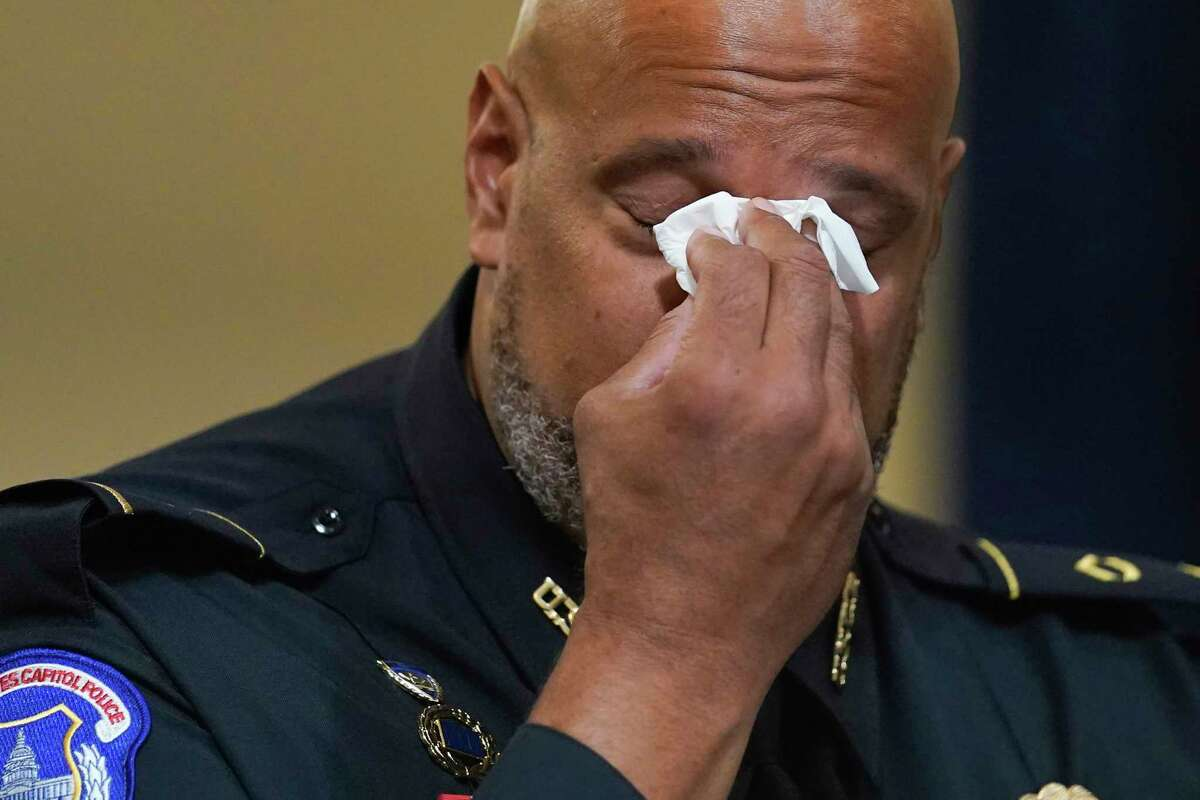 CORRECTS IDENTIFICATION FROM HODGES TO DUNN - U.S. Capitol Police Sgt. Harry Dunn wipes his eyes during the House select committee hearing on the Jan. 6 attack on Capitol Hill in Washington, Tuesday, July 27, 2021.