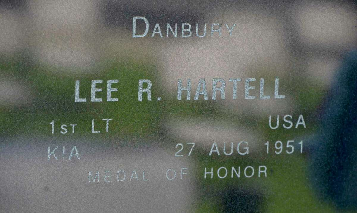 Veteran Sam Jacobellis, of Danbury, placed a rose on the Korean War Memorial in memory of Lee R. Hartell, 1st Lt USA KIA, 27 Aug 1951, Medal of Honor recipient, at the Greater Area Korean War Veterans Assoc. ceremony to mark the 68th anniversary of the end of the Korean War. Rogers Park. Tuesday, July 27, 2021, in Danbury, Conn.