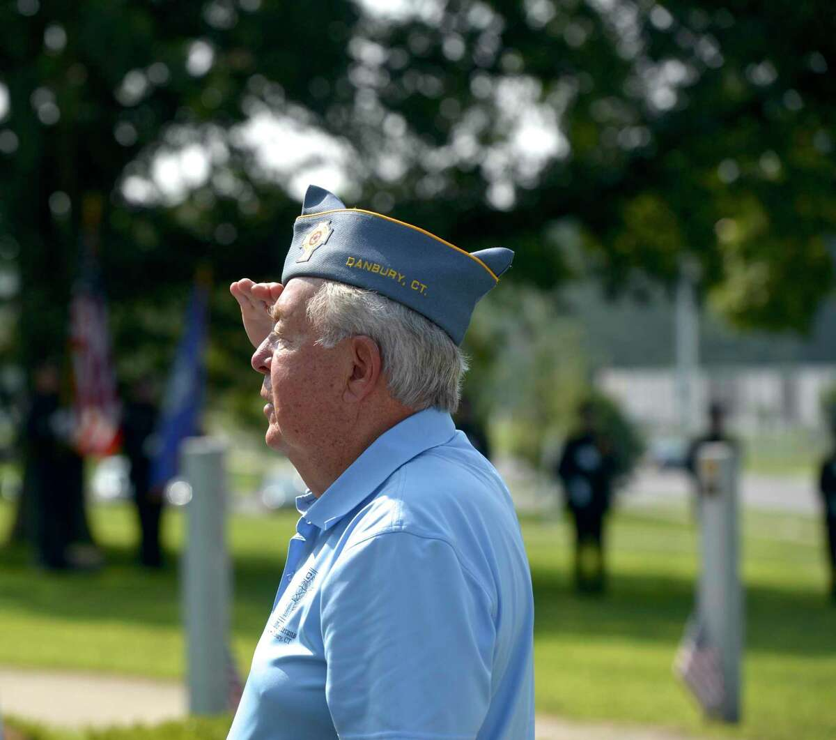 Veteran Al Mead, of Danbury, salutes during the singing of the National Anthem at the Greater Area Korean War Veterans Assoc. ceremony to mark the 68th anniversary of the end of the Korean War. Korean War Memorial in Rogers Park, Tuesday, July 27, 2021, in Danbury, Conn.