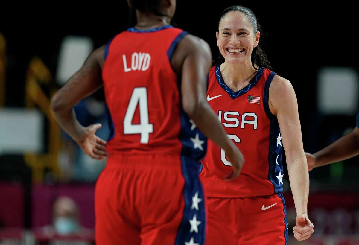 United States' Sue Bird (6), right, celebrates score by teammate Jewell Loyd (4) during women's basketball preliminary round game at the 2020 Summer Olympics, Tuesday, July 27, 2021, in Saitama, Japan. (AP Photo/Eric Gay)