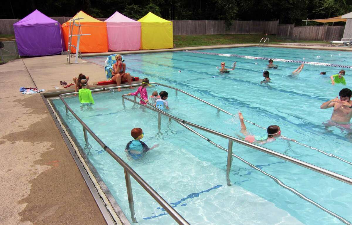 Children swim in the outdoor pool during summer camp at the Jewish Community Center of Greater New Haven in Woodbridge in July 24, 2020.
