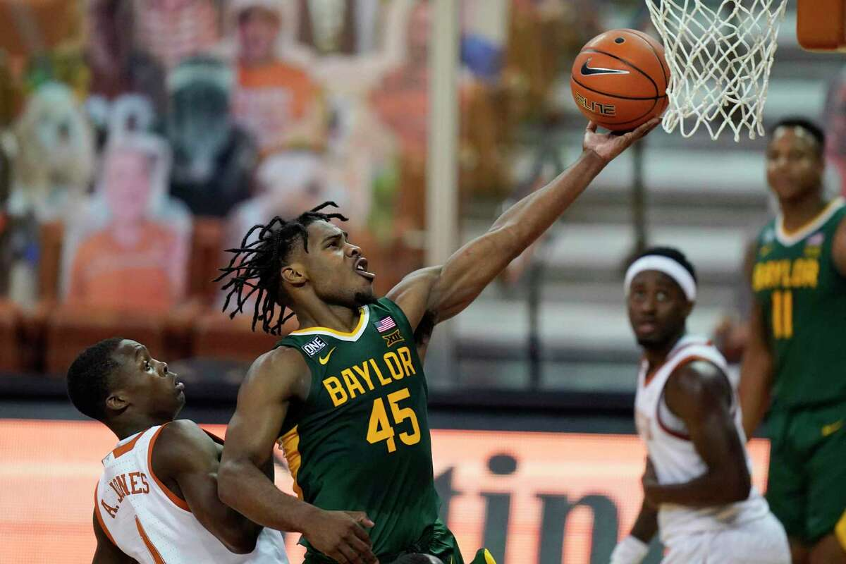 FILE - In this Feb. 2, 2021, file photo, Baylor guard Davion Mitchell (45) drives to the basket past Texas guard Andrew Jones (1) during the second half of an NCAA college basketball game in Austin, Texas. Mitchell is one of the top point guards in the NBA draft after guiding Baylor to the national championship. (AP Photo/Eric Gay, File)