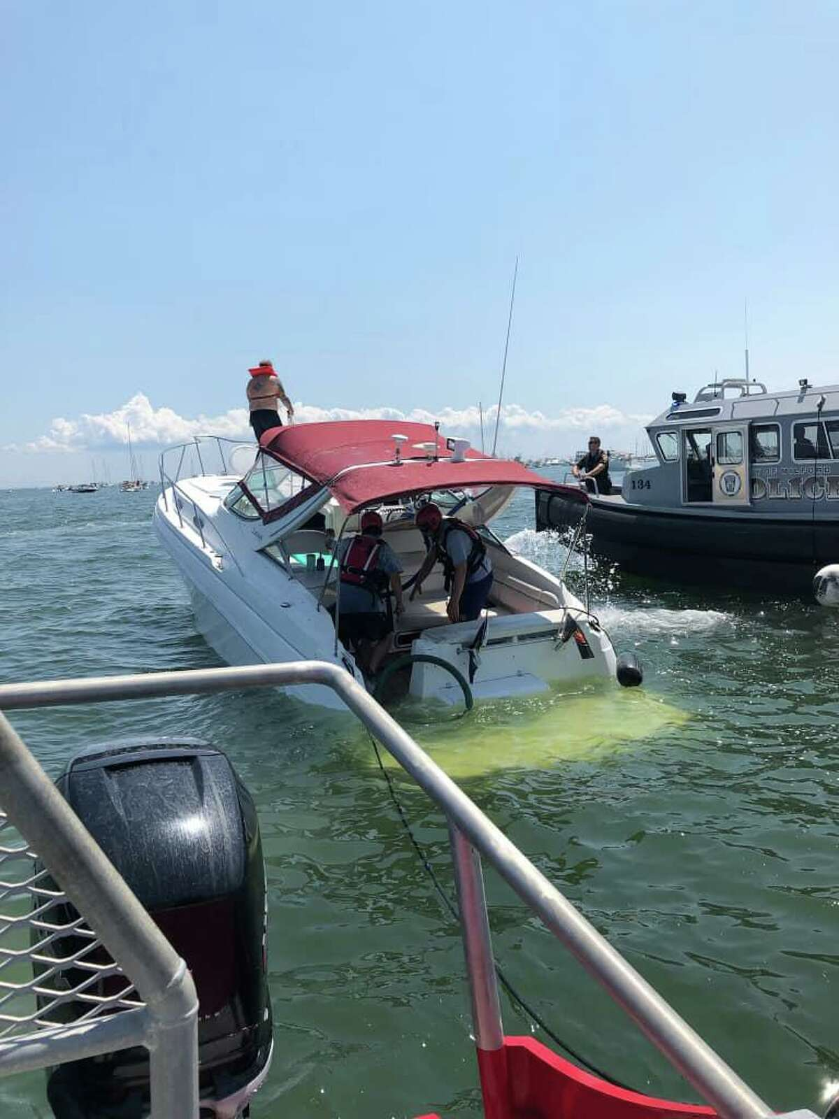 A boat that sank in the water off Milford, Conn., on Saturday, July 24, 2021.