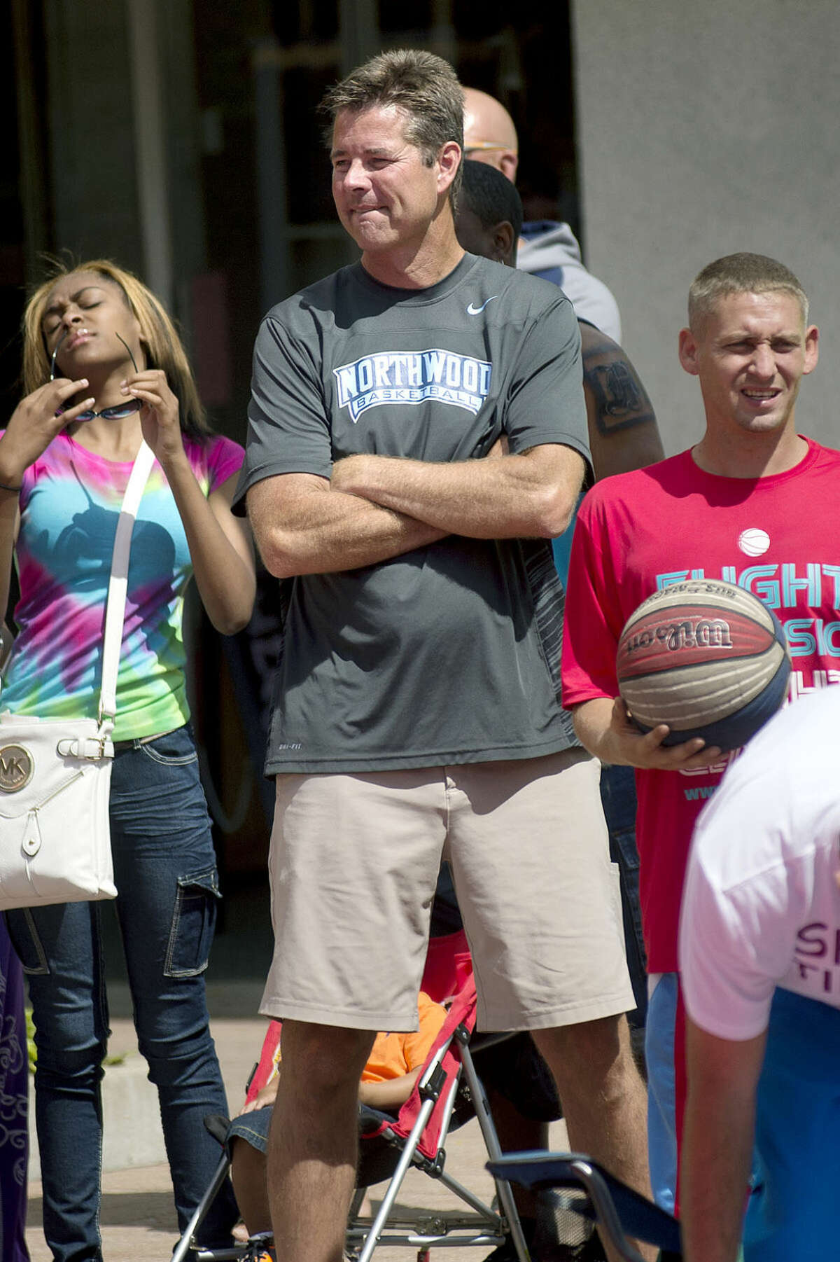 Tournament director Jeff Rekeweg watches the action during the 2014 Gus Macker in downtown Midland.