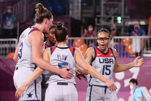 TOKYO, JAPAN - JULY 26: TOKYO, JAPAN - JULY 26: Allisha Gray, Kelsey Plum, Stefanie Dolson and Jacquelyn Young of Team United States celebrate victory in the 3x3 Basketball competition on day three of the Tokyo 2020 Olympic Games at Aomi Urban Sports Park on July 26, 2021 in Tokyo, Japan. (Photo by Christian Petersen/Getty Images)