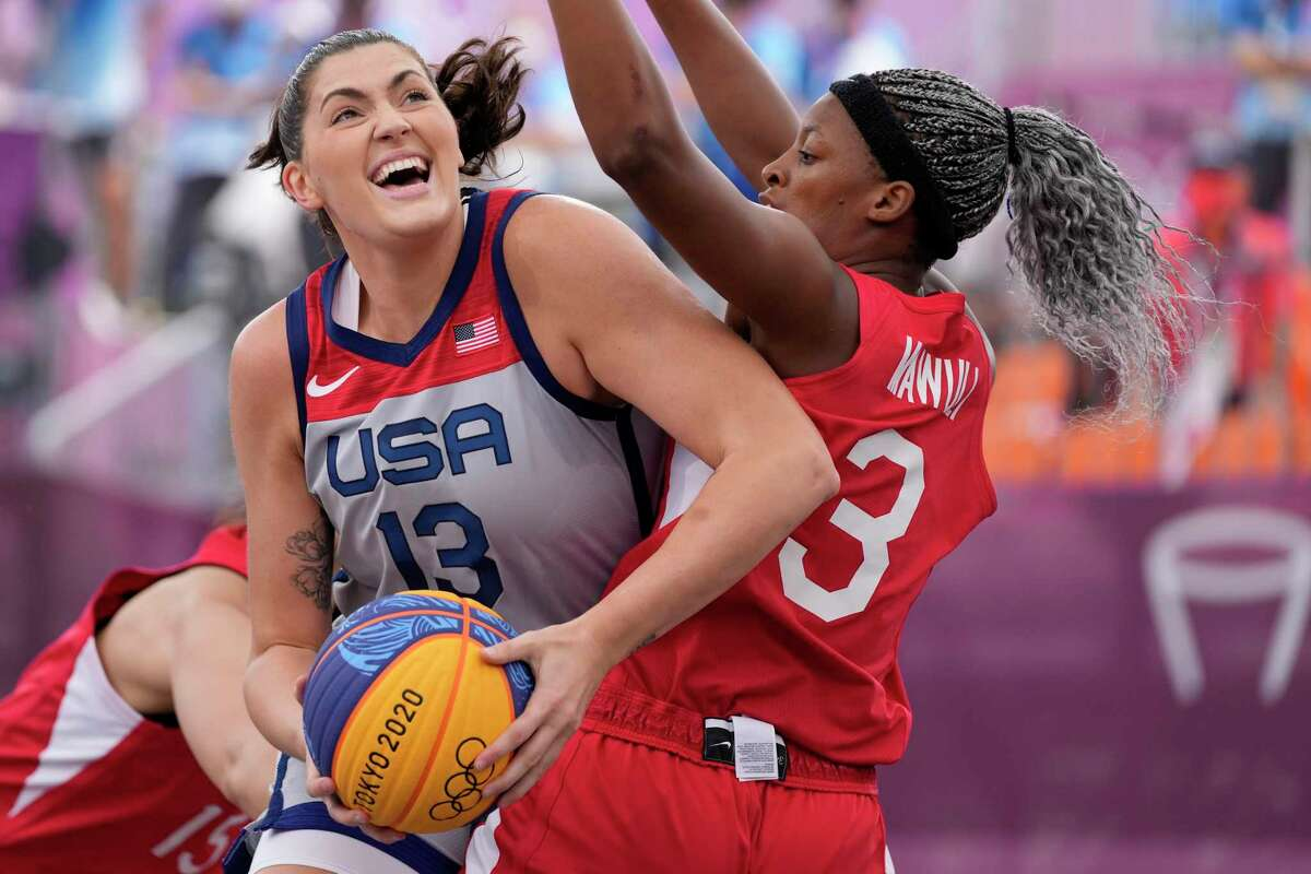 The United States' Stefanie Dolson (13) heads to the basket past Japan's Stephanie Mawuli during a women's 3-on-3 basketball game at the 2020 Summer Olympics on Tuesday.