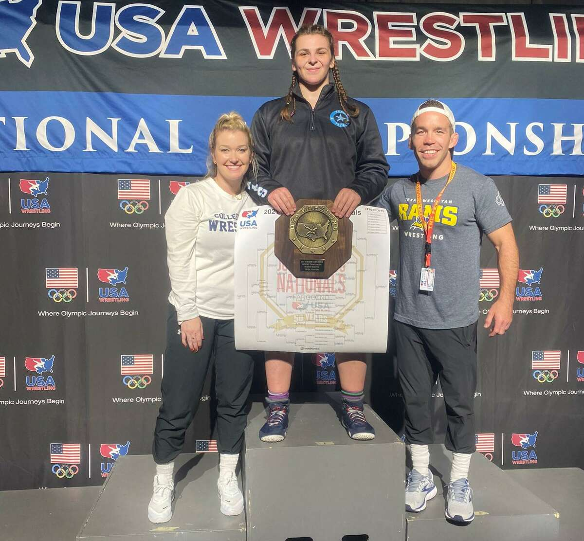 Recent College Park graduate Brittyn Corbishley won the 180 pound weight class at 2021 US Marine Corps Junior Nationals in Fargo, South Dakota on July 21, 2021. Corbishley is shown with College Park assistant coach Lindsey Spjut (left) and College Park head coach Erik Spjut (right).