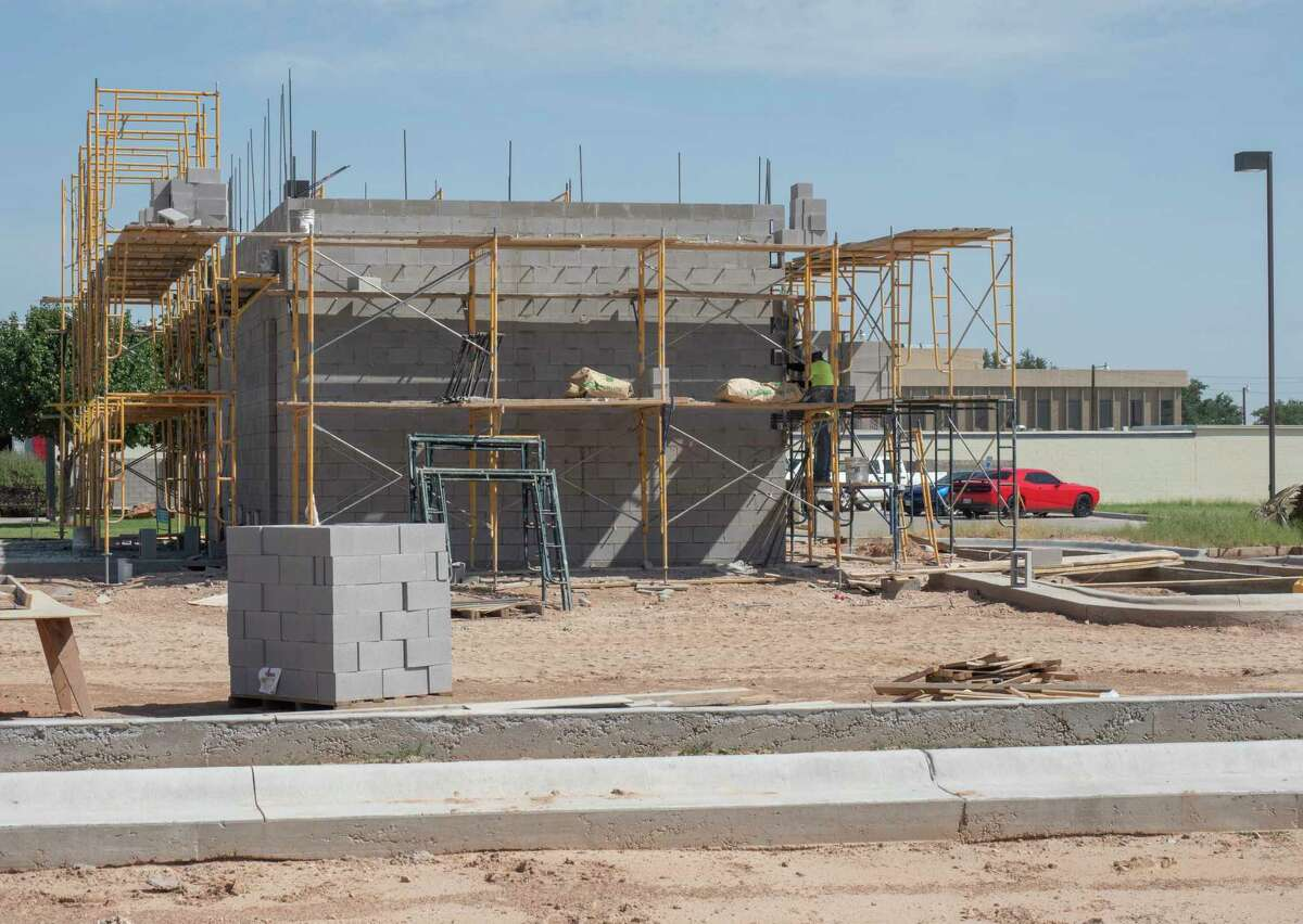 Curbs and foundation have been poured and walls are being constructed for Black Rifle Coffee Company 07/27/2021 at the corner of Big Spring St. and Fiesta Drive. Tim Fischer/Reporter-Telegram