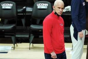 Connecticut head coach Dan Hurley watches from the sideline during the second half of an NCAA college basketball game against Butler Tuesday, Jan. 26, 2021, in Storrs, Conn. (David Butler II/Pool Photo via AP)