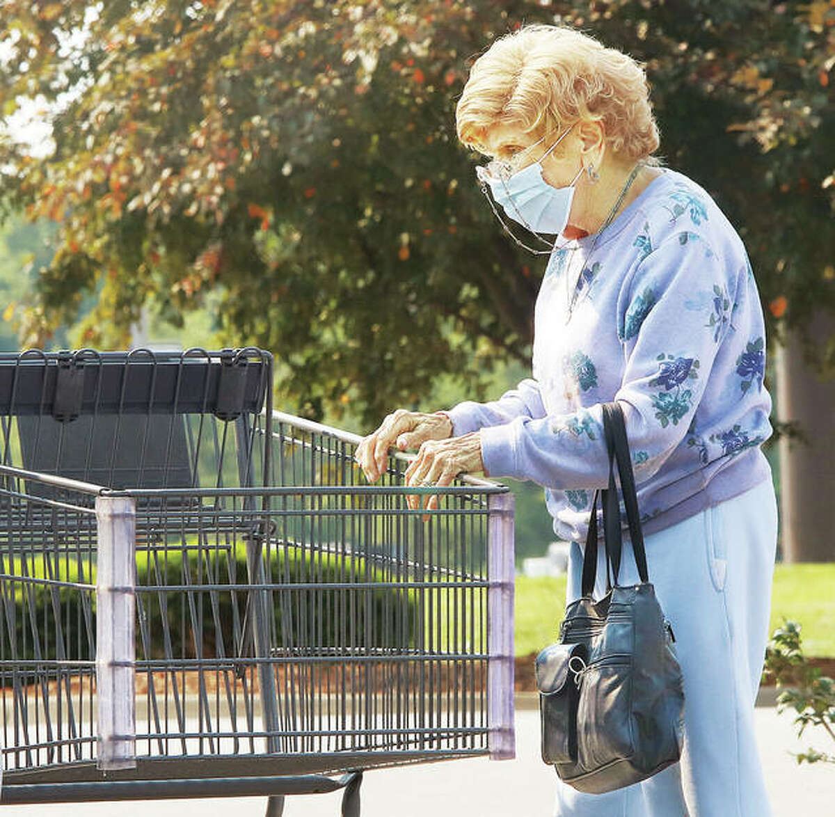 A woman, who was getting help Tuesday unloading her cart at the Alton Aldi store, was not taking any chances by wearing her mask. St. Louis City and St. Louis County recently reinstated mask mandates and Madison County had 27 people in hospitals from Covid-19 Tuesday.