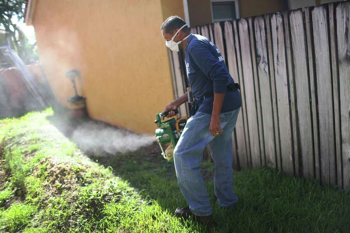 Amosquito control inspector uses a fogger to spray pesticide to kill mosquitos in Miami. The Michigan Department of Agriculture and Rural Developmentadvises only hiring licensed mosquito control companies.(Photo by Joe Raedle/Getty Images)
