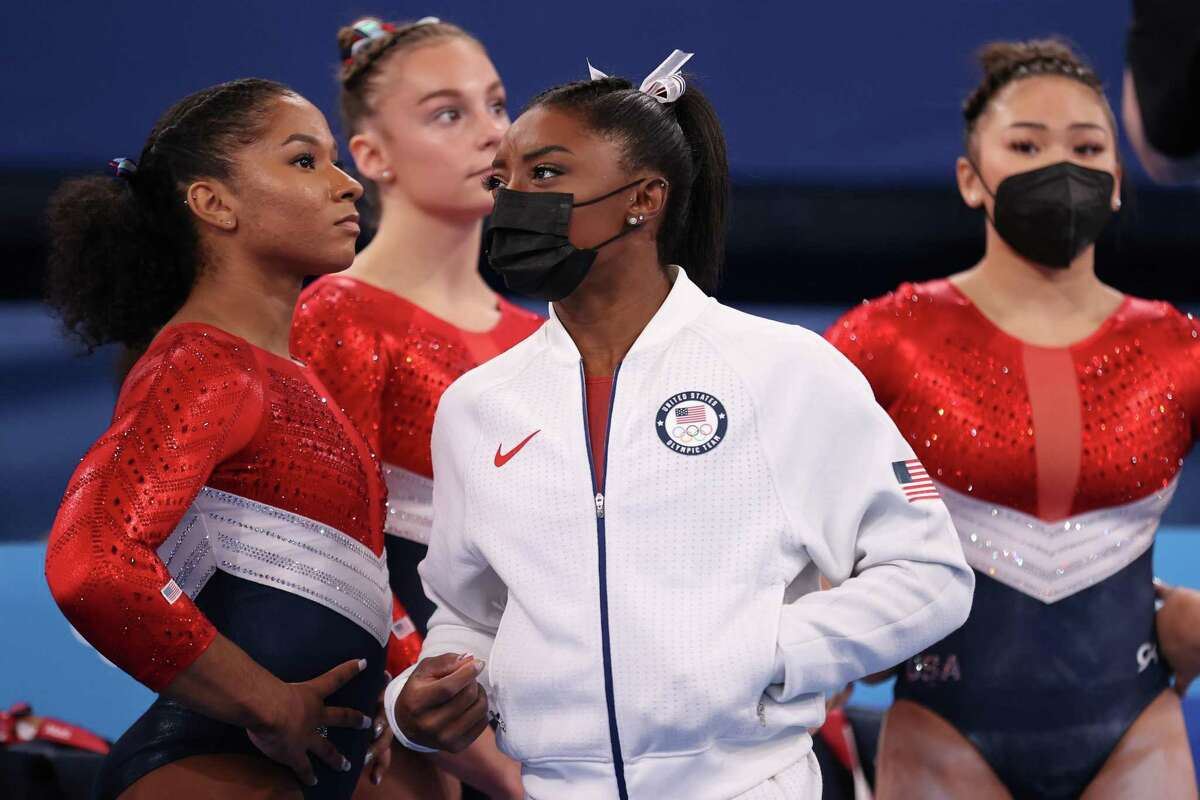 TOKYO, JAPAN - JULY 27: (L-R) Jordan Chiles, Grace McCallum, Simone Biles and Sunisa Lee of Team United States look on during the Women's Team Final on day four of the Tokyo 2020 Olympic Games at Ariake Gymnastics Centre on July 27, 2021 in Tokyo, Japan. (Photo by Laurence Griffiths/Getty Images)