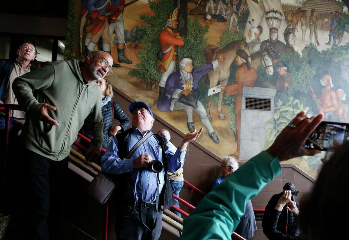 A judge has ruled the S.F. school board's vote to cover up the 1936 mural at George Washington High School violated the law.