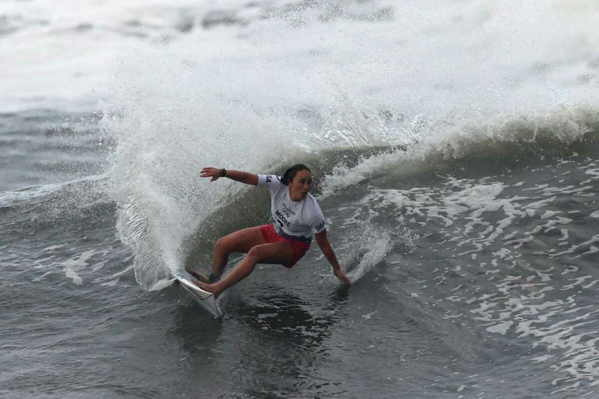 ICHINOMIYA, JAPAN - JULY 27: Carissa Moore of Team United States surfs during the Gold Medal match against Bianca Buitendag of Team South Africa on day four of the Tokyo 2020 Olympic Games at Tsurigasaki Surfing Beach on July 27, 2021 in Ichinomiya, Chiba, Japan. (Photo by Ryan Pierse/Getty Images)