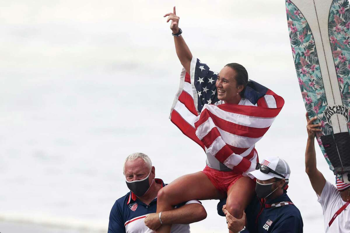 ICHINOMIYA, JAPAN - JULY 27: Carissa Moore of Team United States celebrates winning the Gold Medal after her final match against Bianca Buitendag of Team South Africa on day four of the Tokyo 2020 Olympic Games at Tsurigasaki Surfing Beach on July 27, 2021 in Ichinomiya, Chiba, Japan. (Photo by Ryan Pierse/Getty Images)