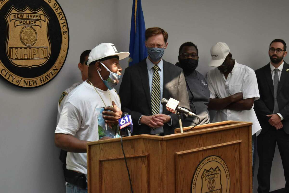 Arnold Payne speaks at a press conference Tuesday at which police announced an arrest in the slaying of Payne's daughter, Natosha Gaines in October 2020.