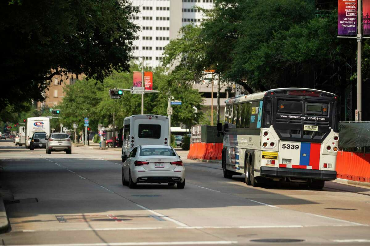 A Metropolitan Transit Authority bus travels north on Travis Street near Metro's downtown transit center on July 20, 2021, in Houston. Officials plan to paint the right lane on Travis and Milam as a red bus only lane between Pierce and Commerce.