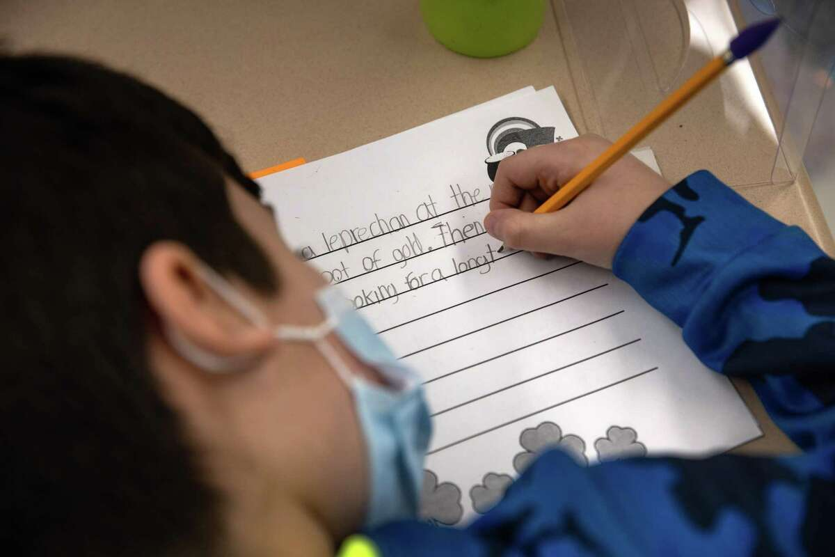 In this file photo, a student takes part in class after returning to in-person learning five days a week.