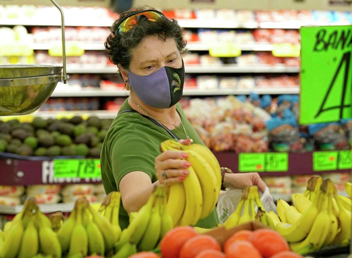 Shirley Pridham wears a mask as she shops at Food Town, 5367 Antoine Dr., Tuesday, July 27, 2021 in Houston. Wearing a mask is optional at the store.
