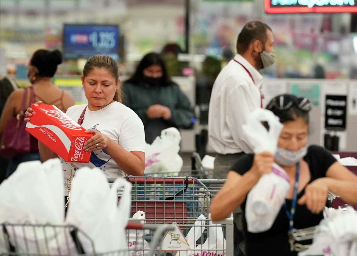 Shoppers check out at Food Town, 5367 Antoine Dr., Tuesday, July 27, 2021 in Houston. Wearing a mask is optional at the store.