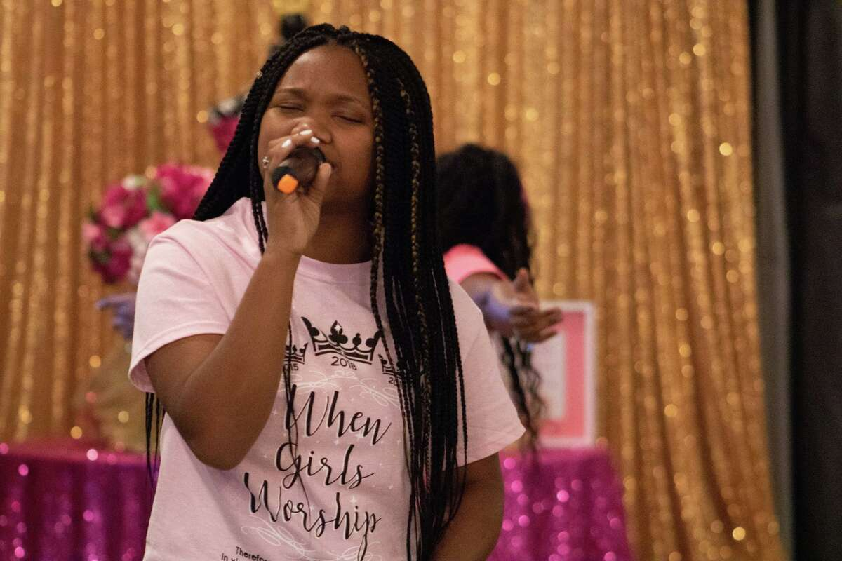 A participant of a When Girls Worship event sings. When Girls Worship is hosting a back to school brunch for girls 13-21 on Aug. 14.