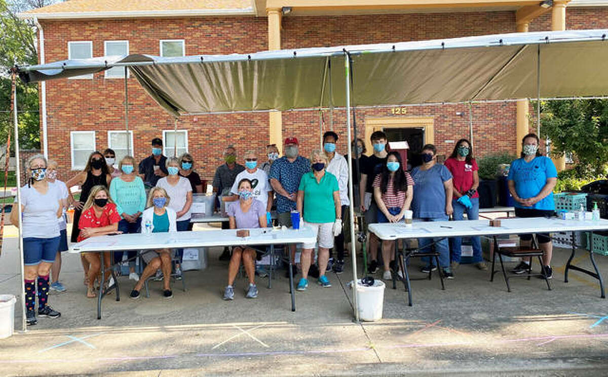 Volunteers and staff members from Glen-Ed Pantry prepare to distribute items during last year's annual school supplies drive. This year's distribution is scheduled for 9-11 a.m. on Saturday, Aug. 7.