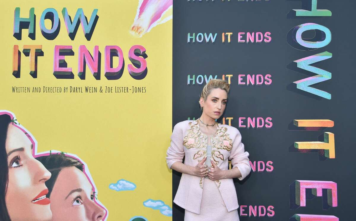 """Writer/Director/Producer/Actor Zoe Lister-Jones arrives for the premiere of """"How It Ends"""" at NeueHouse Hollywood in Los Angeles, July 15, 2021. (Photo by Chris Delmas / AFP) (Photo by CHRIS DELMAS/AFP via Getty Images)"""