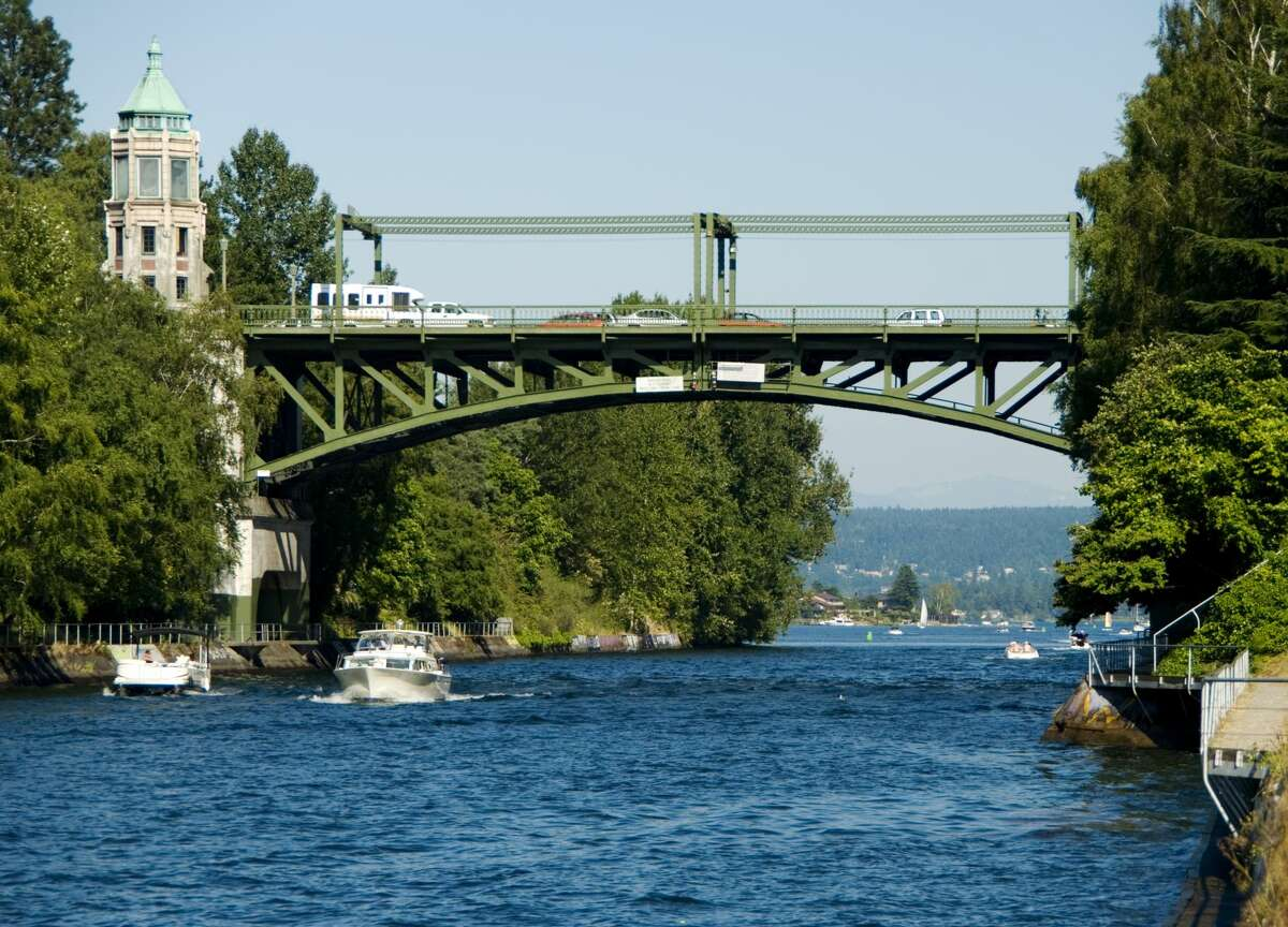 Boaters pass under Seattle's Montlake Bridge.