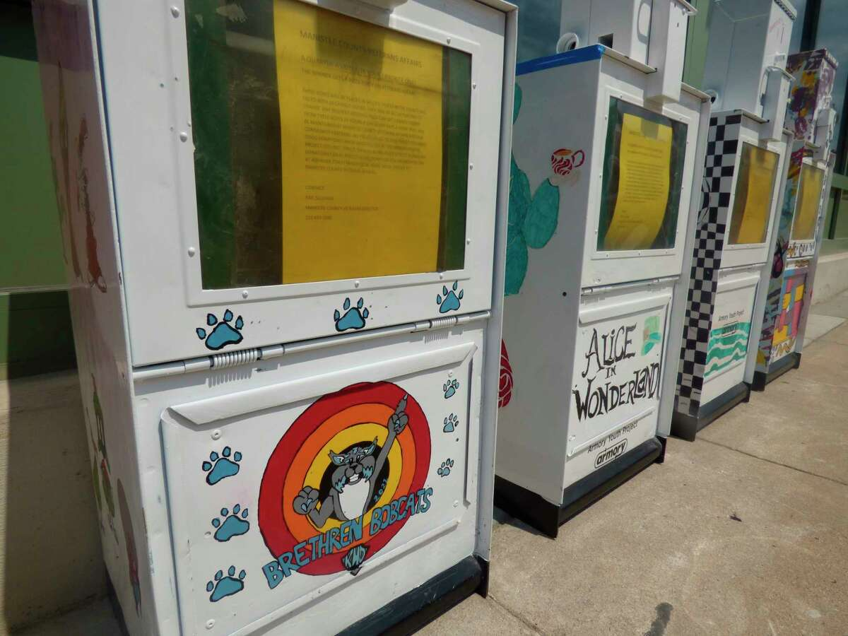 Old newspaper racks were decorated by local youth in spring to serve as food pantries that will be placed next week at locations around Manistee County. (Scott Fraley/News Advocate)