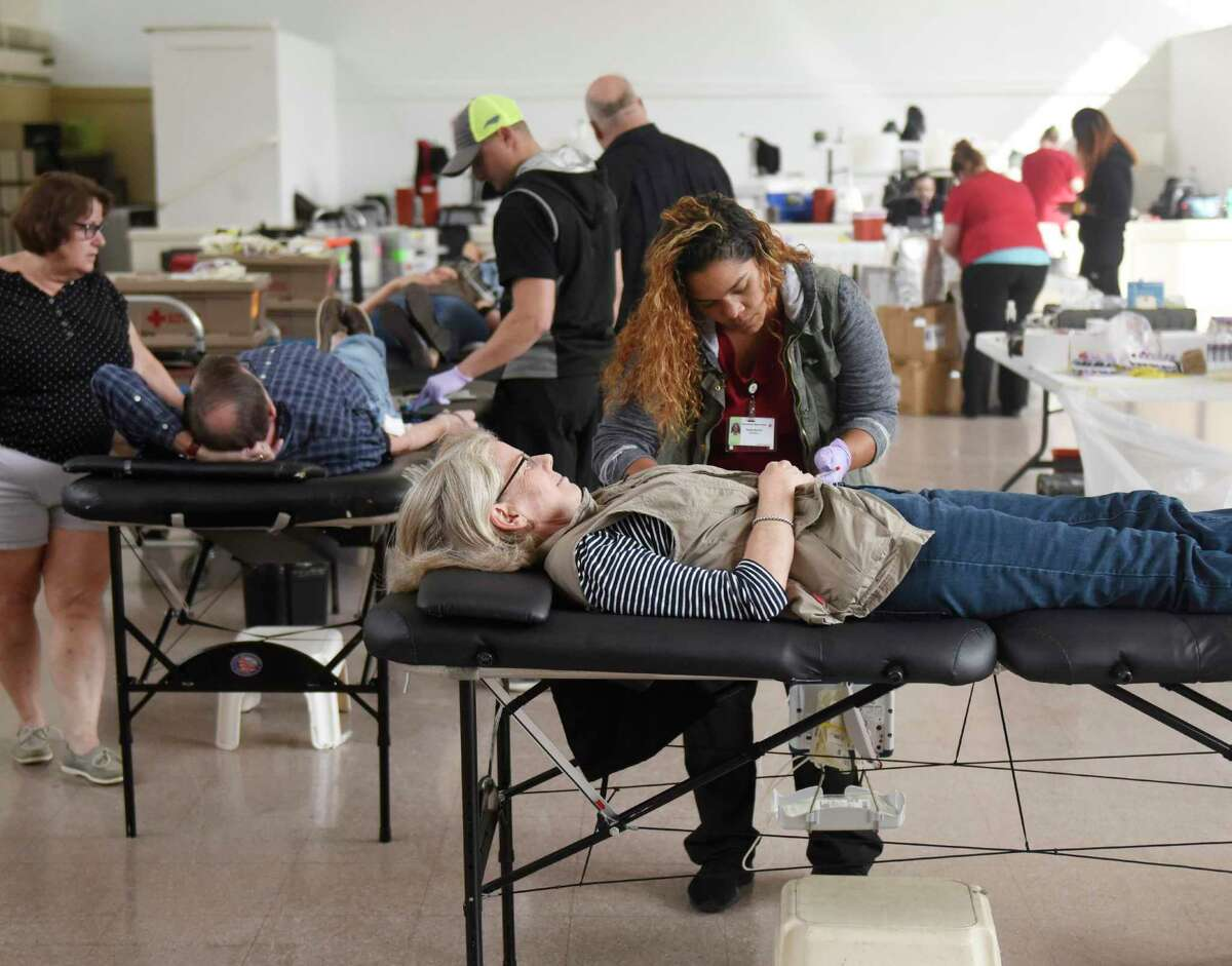 A Greenwich resident donates blood during a drive on Monday, Oct. 7, 2019.