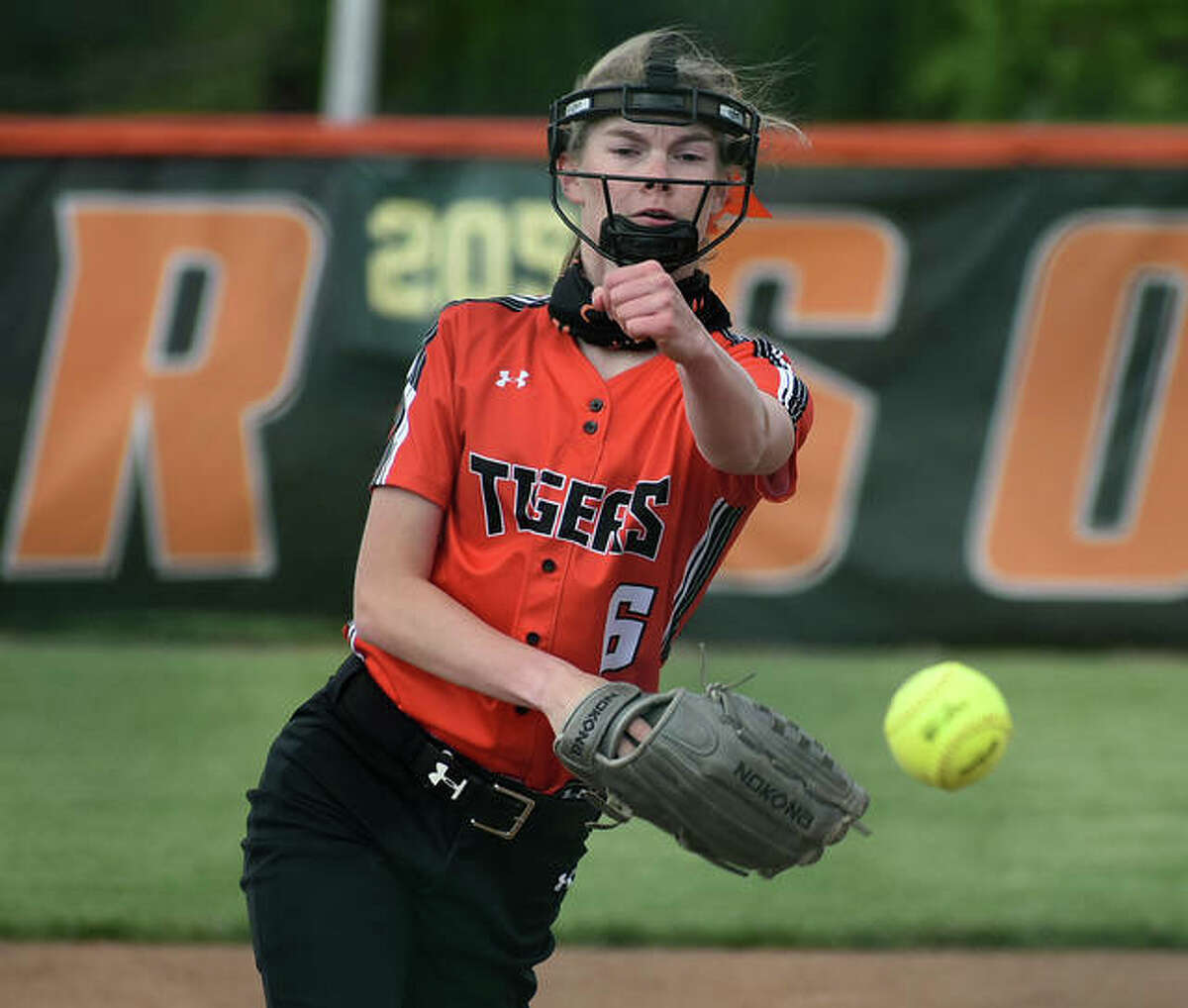 Edwardsville starting pitcher Ryleigh Owens delivers a pitch to a Collinsville hitter in the first inning of a game in Edwardsville.