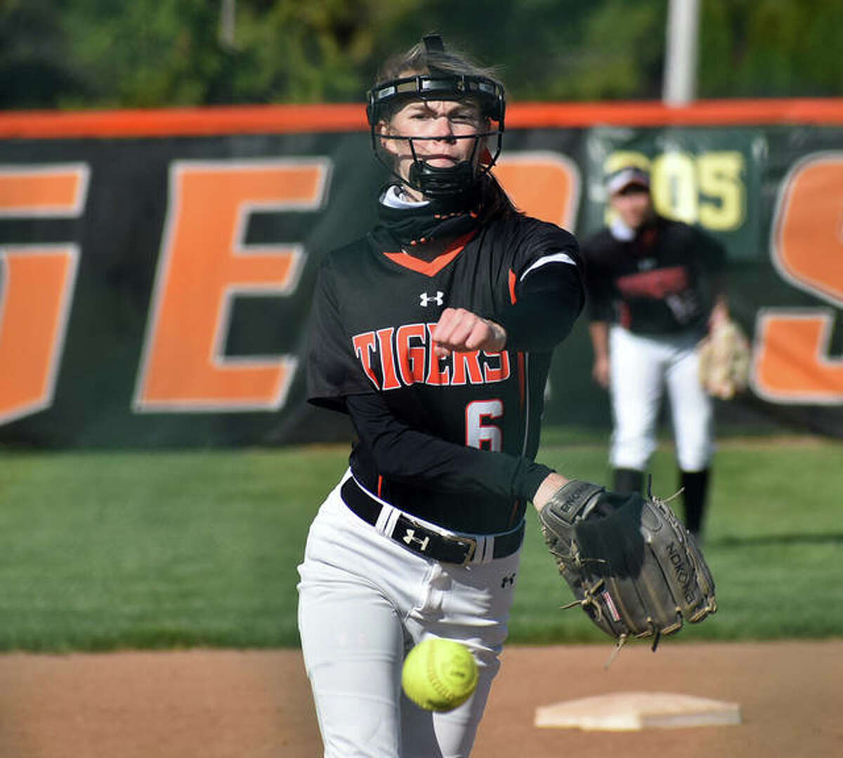Edwardsville's Ryliegh Owens delivers the first pitch of the game and the 2021 season.