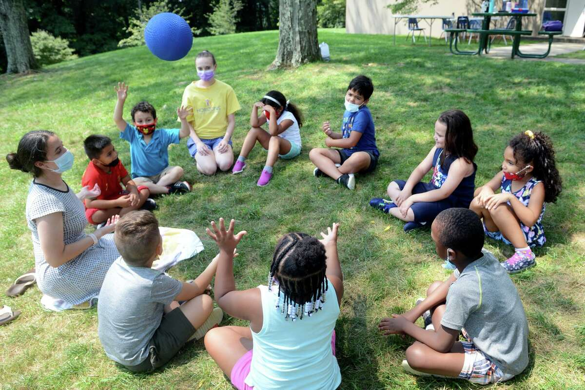 Students from the Horizons program play during an outdoors activity period at Notre Dame High School, in Fairfield, Conn. July 27, 2021.