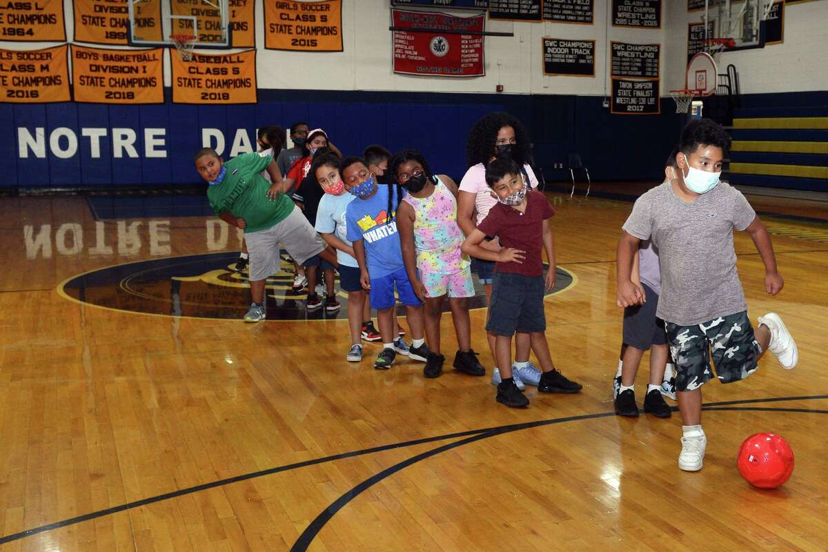 Students from the Horizons program play soccer during a gym period at Norte Dame High School, in Fairfield, Conn. July 27, 2021.