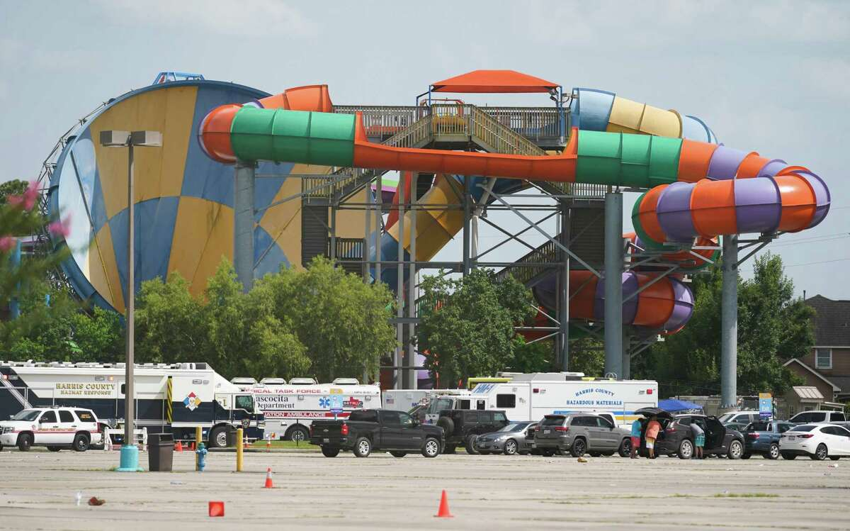 Emergency personnel treat people after a chemical leak at Six Flags Hurricane Harbor Splashtown on July 17. Hundreds have joined a lawsuit against Six Flags, saying the company was negligent in its handling of the matter.