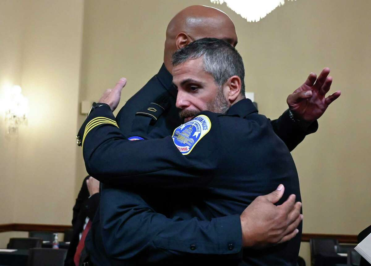 Washington, D.C., Metropolitan Police Officer Michael Fanone, right, hugs U.S. Capitol Police Officer Harry Dunn after a House select committee hearing on the Jan. 6 attack on the Capitol.