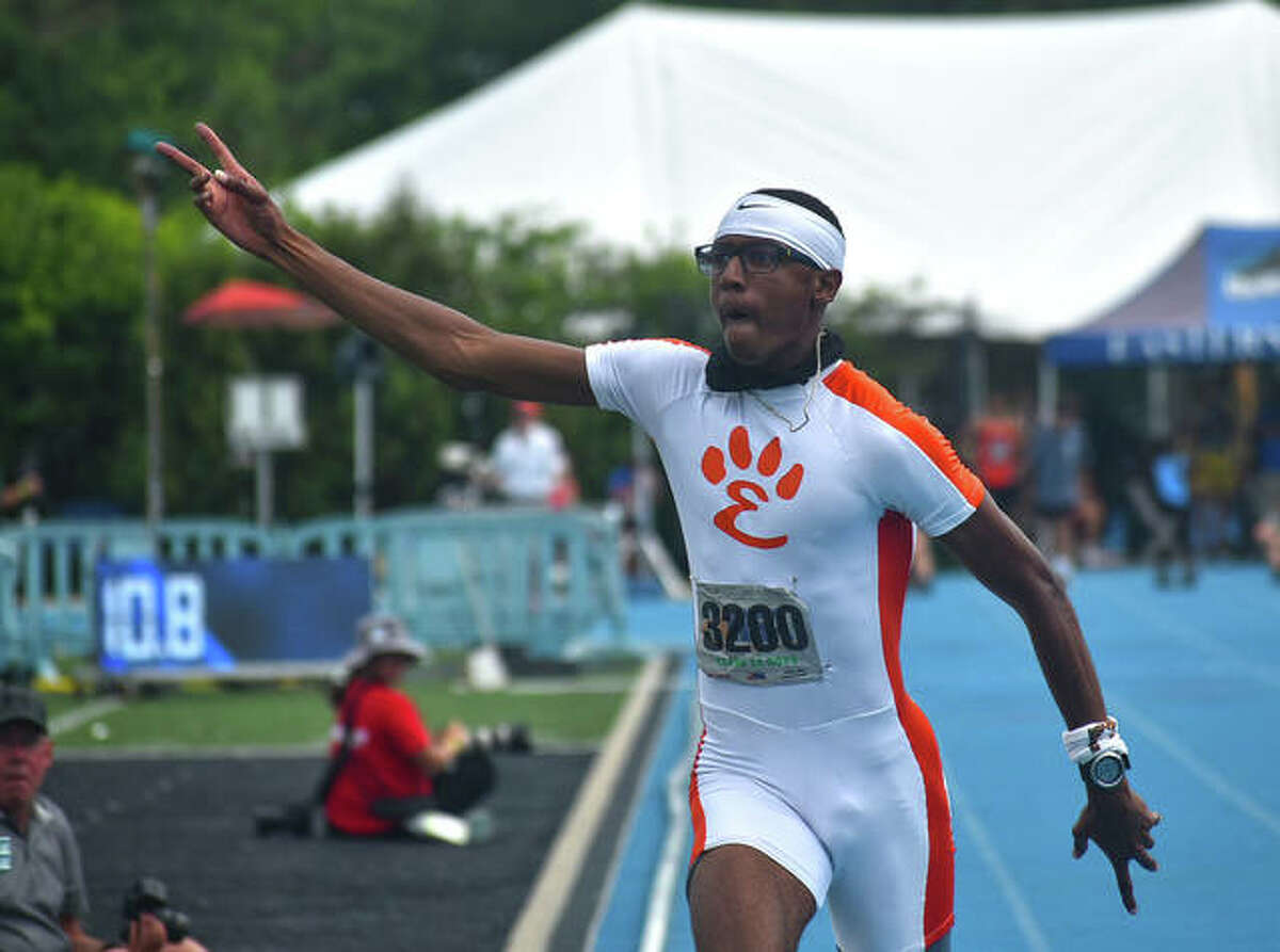 Edwardsville senior Brandon Battle celebrates as he crosses the finish line for the 100-meter dash at the Class 3A state meet in Charleston.