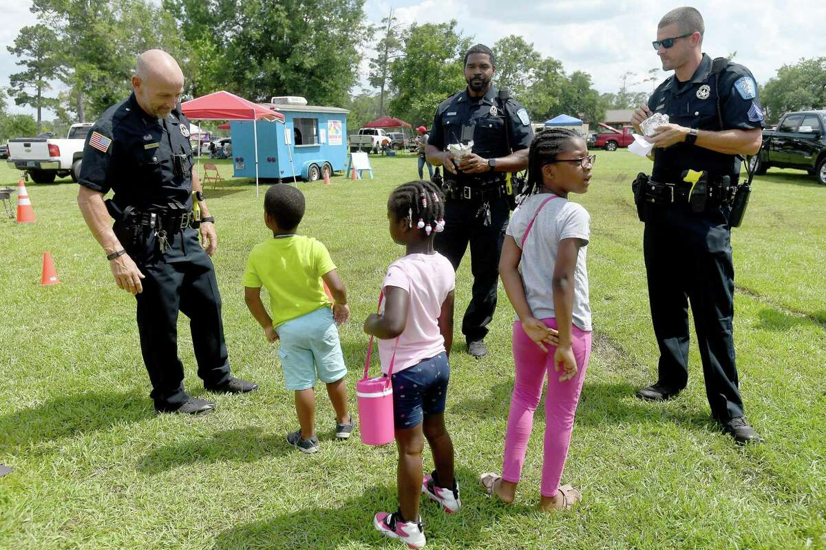 Beaumont police talk with children during Beaumont's annual Juneteenth celebration in Tyrrell Park Saturday. Photo made Saturday, June 19, 2021 Kim Brent/The Enterprise