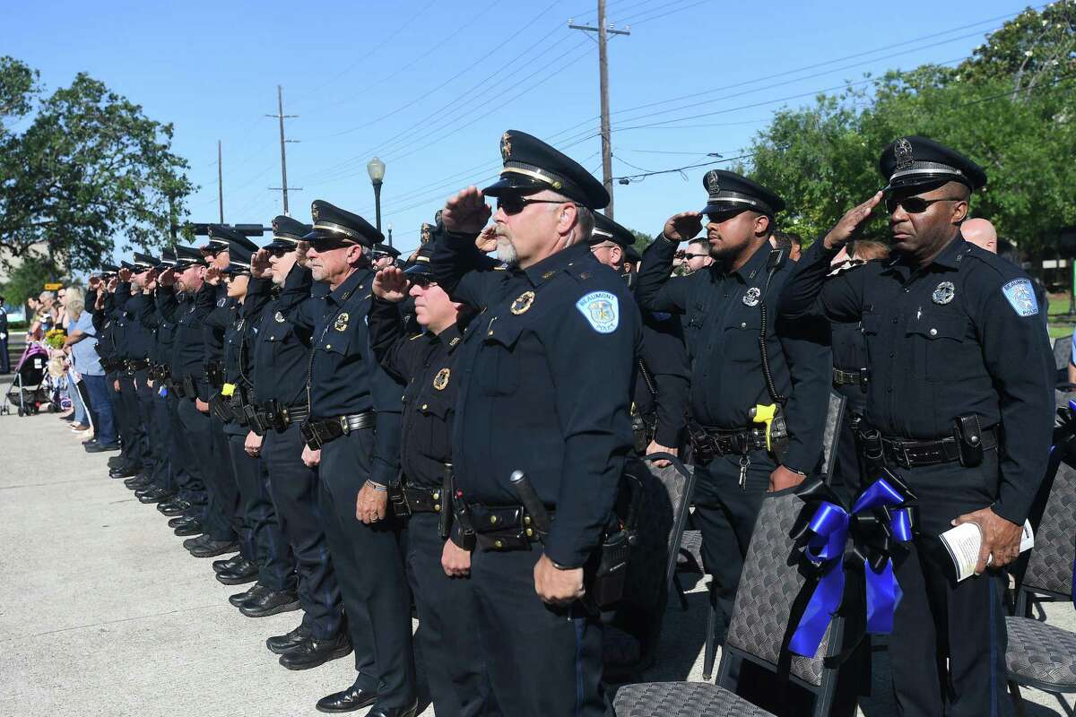 A crowd gathers for the annual Beaumont Police Department's memorial ceremony in remembrance of the 18 officers who have fallen in the line of duty, the most recent of which was Sheena Yarbrough-Powell, who was killed in August, 2020. Photo made Thursday, May 13, 2021 Kim Brent/The Enterprise
