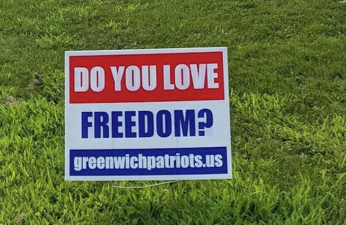 """Greenwich police said two people have been charged with misdemeanor larceny in the last week in connection with the theft of signs belonging to Jackie Homan and the Greenwich Patriots. The signs in question pose a single question: """"Do you value freedom?"""""""